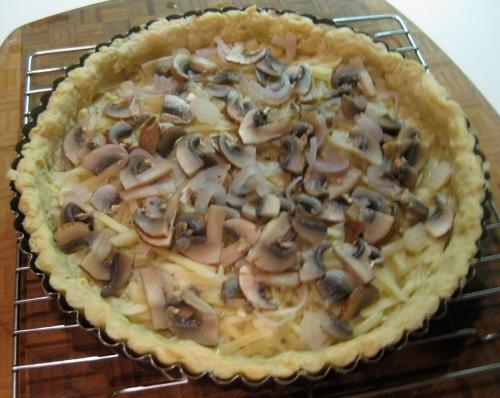 mushroom & shallot over shredded gruyere & swiss